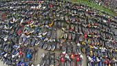 Scrapped vehicles are pictured on a scrapyard on June 4 2015 in Hangzhou Zhejiang province of China Most of those vehicles were impounded after...