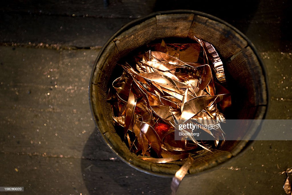 Scraps of copper metal sit pild in a wooden barrell on the floor of the fabrication area at the D Picking & Co. facility in Bucyrus, Ohio, U.S., on Tuesday, Dec. 11, 2012. Copper rose on bets that moves by the Federal Reserve to expand economic stimulus will weaken the dollar and boost demand in the U.S., the world's second-largest user of the metal. Photographer: Ty Wright/Bloomberg via Getty Images