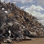 CONTENT] Scrapyard Dagenham rust tangled scrap metal sunny decay pressed metal summer london industry