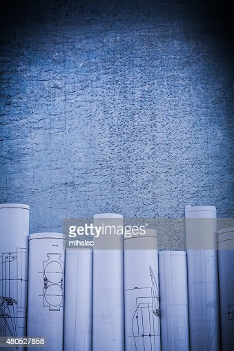 Scratched metallic surface with blueprint rolls construction con : Stockfoto
