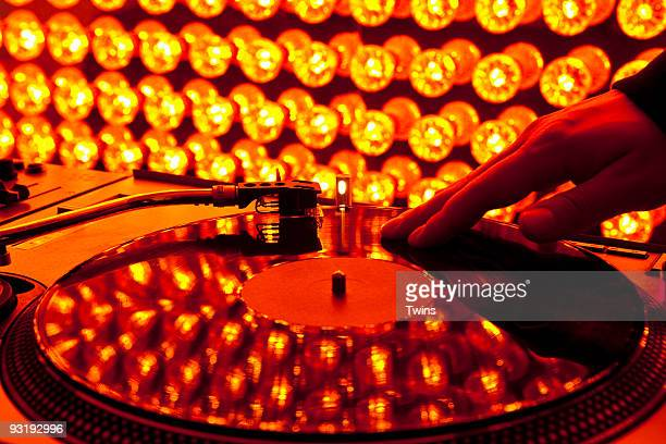 A DJ scratching a record at a nightclub