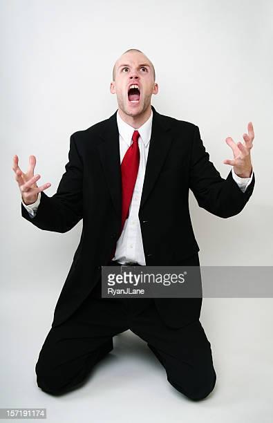Screaming 怒っている若いビジネス男