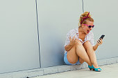 Young woman screaming in the phone