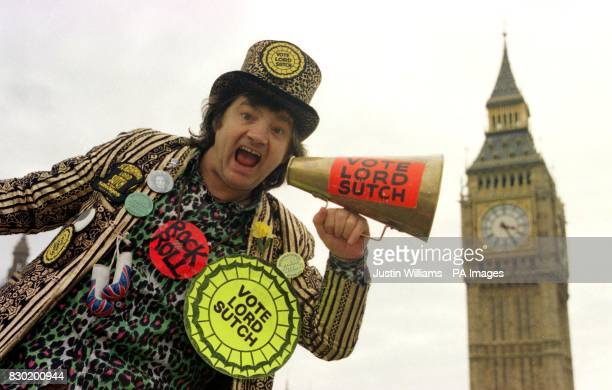 Screaming Lord Sutch the former rock singer who brought zany humour to British politics with his Monster Raving Loony Party posing for a photo in...