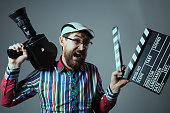 http://www.istockphoto.com/photo/screaming-male-retro-movie-camera-and-clapperboard-gm639306774-115138981
