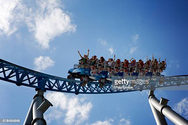 screaming people of all ages riding roller coaster