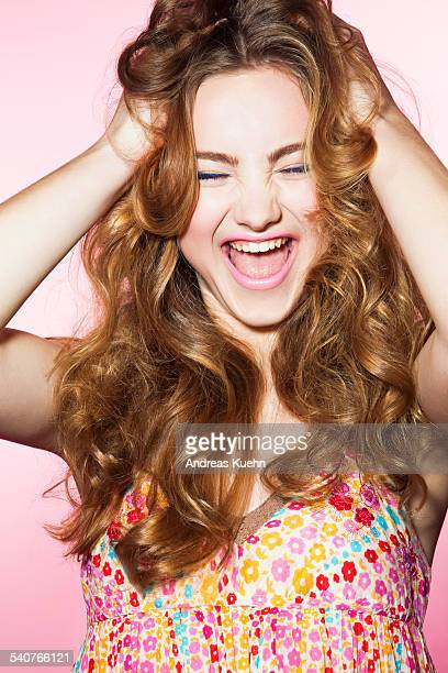 Screaming young teenage girl with long hair.