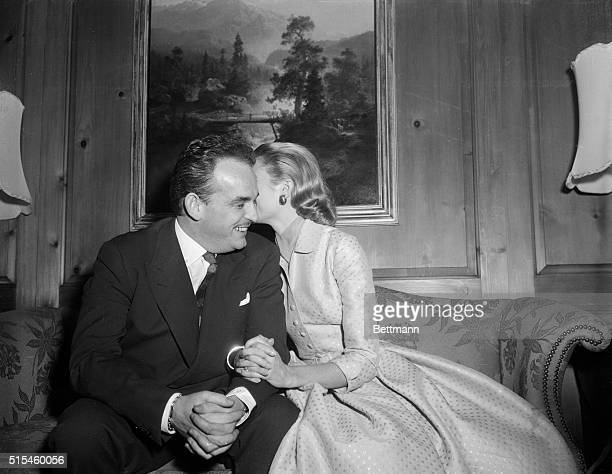 Screen actress Grace Kelly bends over to kiss future husband Prince Rainier III of Monaco Europe's most eligible bachelor They are shown at the home...