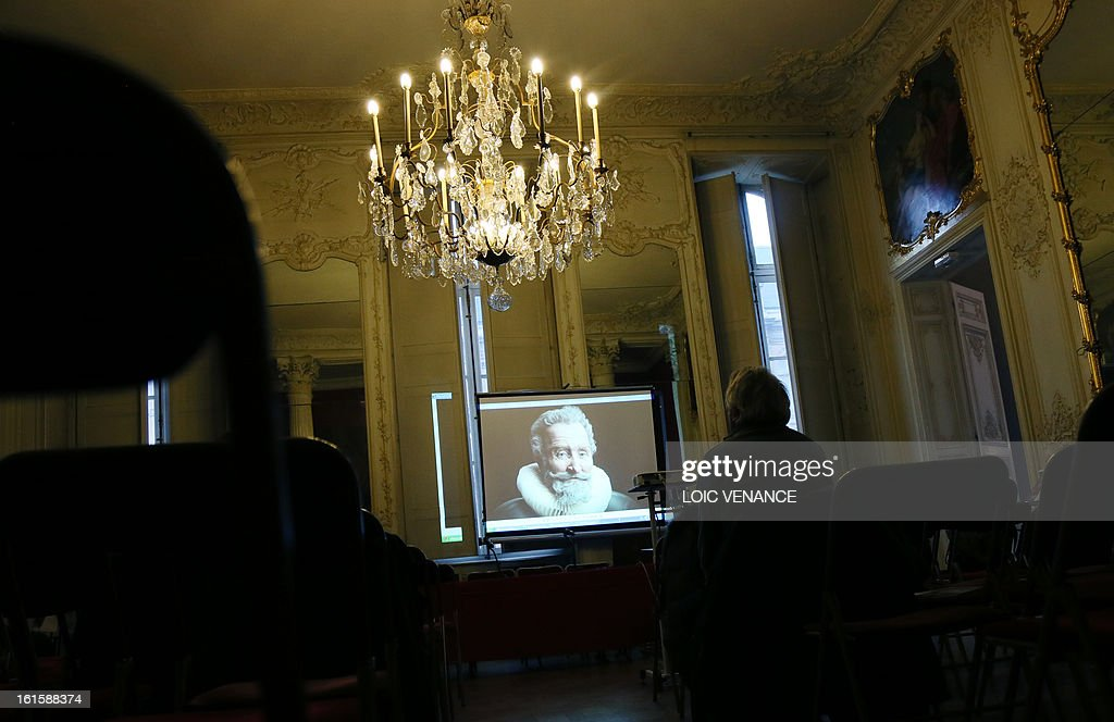 A screen bears the reconstruction of the head of French King Henri IV (1553-1610) during a press conference in Paris on February 12, 2013. This reconstruction was made three years after a panel of forensic scientists identified the skull of the king who was murdered at the age of 57 on May 14, 1610, by a fanatic. Scientists headed by France's Philippe Charlier found a common genetic profile between the mummified head of Henri IV and dried blood from his descendant, Louis XVI.