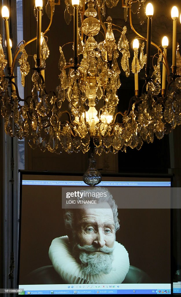A screen bears the reconstruction of the head of French King Henri IV (1553-1610) during a press conference in Paris on February 12, 2013. This reconstruction was made three years after a panel of forensic scientists identified the skull of the king who was murdered at the age of 57 on May 14, 1610, by a fanatic. Scientists headed by France's Philippe Charlier found a common genetic profile between the mummified head of Henri IV and dried blood from his descendant, Louis XVI. AFP PHOTO LOIC VENANCE