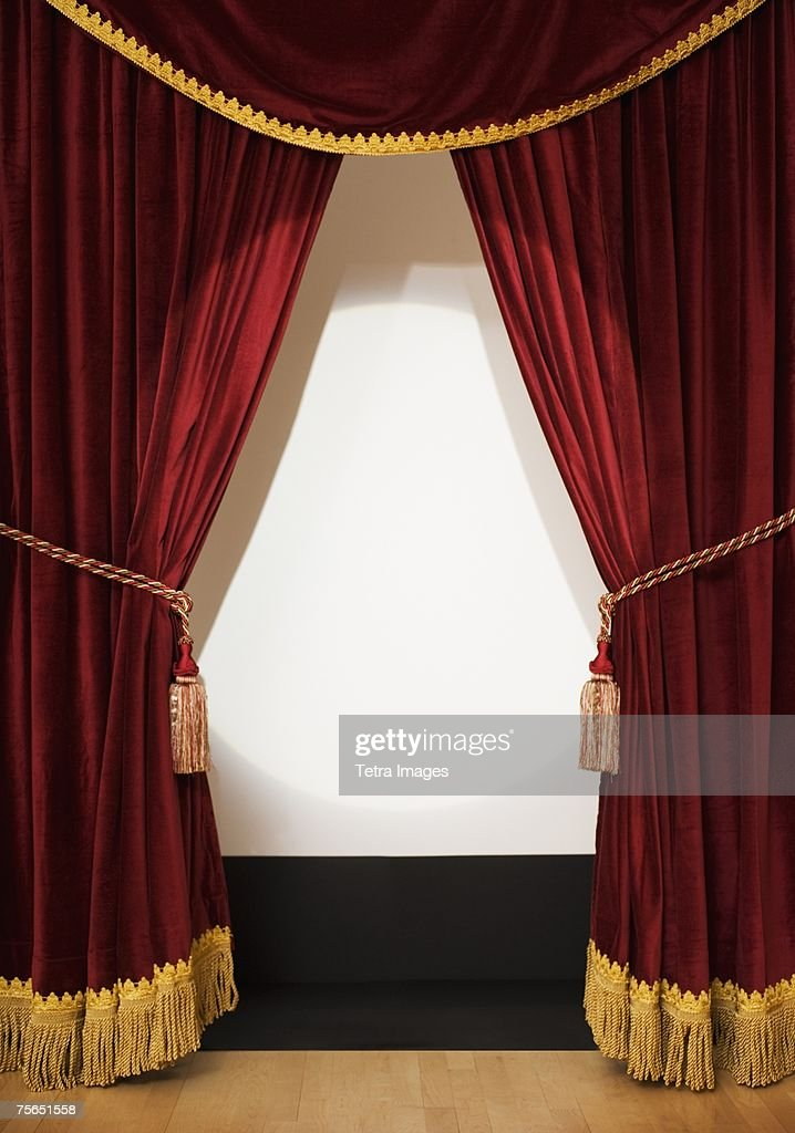 Screen behind open stage curtains
