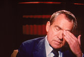Screen capture of former American President Richard Milhous Nixon rubs his head during an interview on 'Frost On America' a television program hosted...