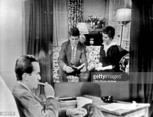 Screen capture shows American journalist Edward R Murrow as he interviews American politician Senator John F Kennedy and his wife future First Lady...