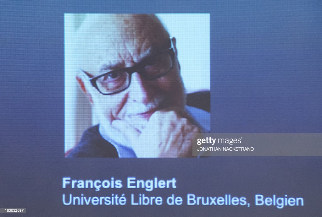 A screen displays a photo of Belgian theoretical physicist Francois Englert as he and British theoretical physicist and Peter Higgs were awarded laureates of the 2013 Nobel Prize in Physics during a press conference on October 8, 2013 at the Nobel Assembly at the Royal Swedish Academy of Sciences in Stockholm. NACKSTRAND