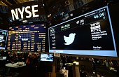 A screen displays a Twitter and share price logo as it starts trading at the New York Stock Exchange on November 7 2013 in New York Twitter hit Wall...