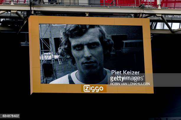 A screen displays an image of the recently died Ajax' football player Piet Keizer during a tribute prior to the Dutch Eredivisie football match...