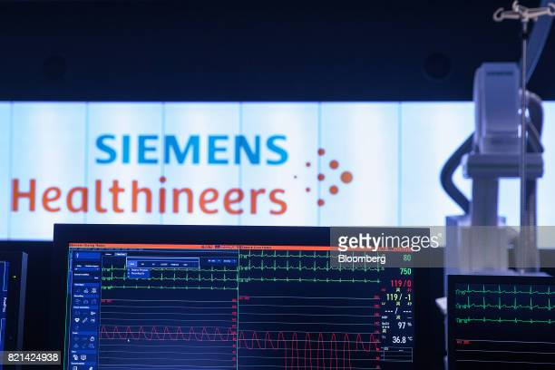 A screen displays electrocardiogram signals inside the Siemens AG Healthineers showroom in Forchheim Germany on Wednesday July 19 2017 Siemens said...