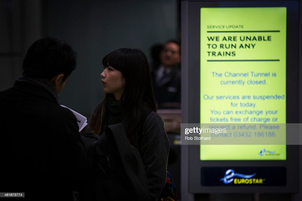 A screen displays information about cancelled Eurostar trains at Saint Pancras International on January 17 2015 in London England Passengers face...