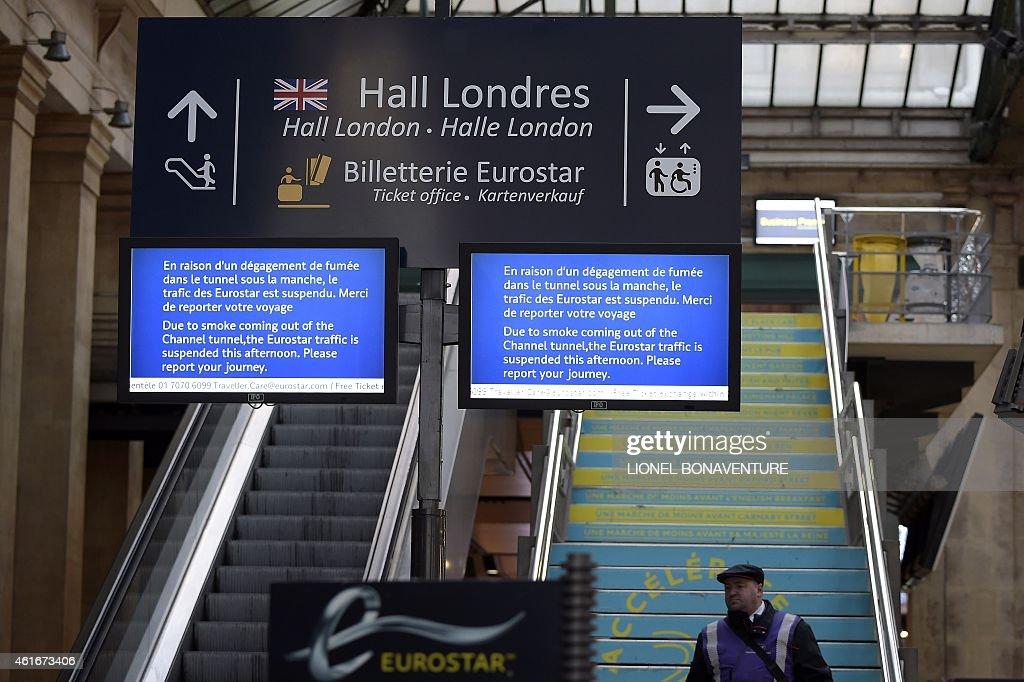 A screen displays information regarding suspended Eurostar traffic near the 'Hall London' at Gare du Nord international railway station in Paris on...