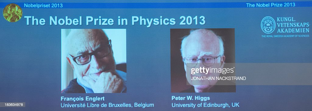 A screen displays photos of Belgian theoretical physicist Francois Englert (L) and British theoretical physicist Peter Higgs (R) both awarded laureates of the 2013 Nobel Prize in Physics during a press conference on October 8, 2013 at the Nobel Assembly at the Royal Swedish Academy of Sciences in Stockholm. NACKSTRAND