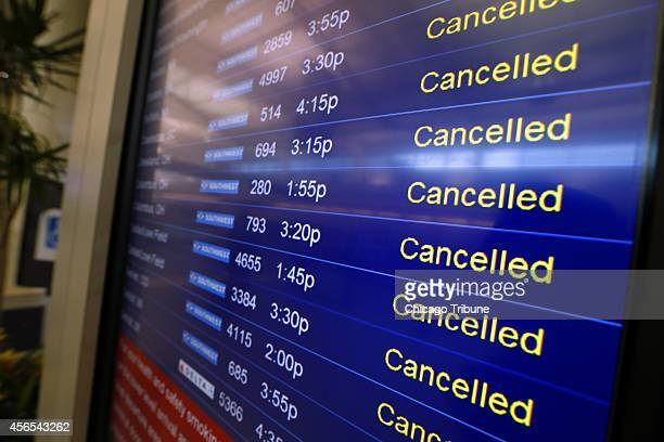 A screen displays Southwest Airlines' extensive flight cancellations at Chicago Midway International Airport on Thursday Oct 2 2014 The airline...