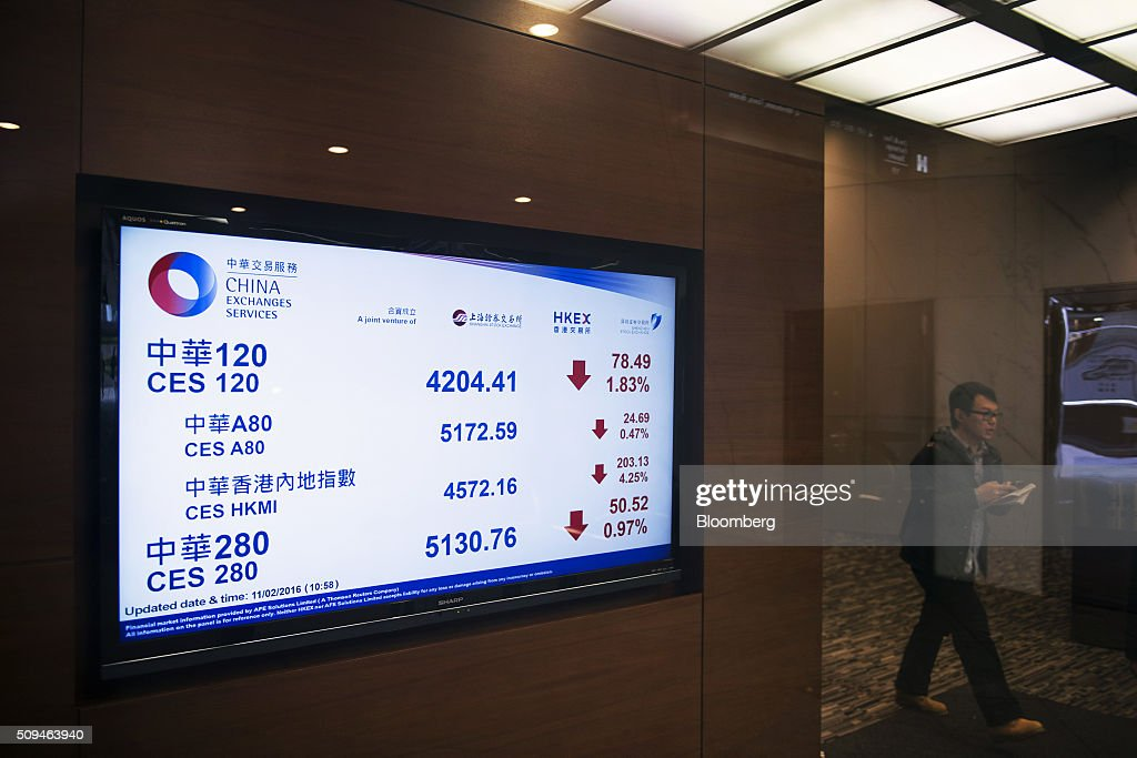 A screen displays stock prices at the Hong Kong Exchanges and Clearing Ltd. (HKEx) building in Hong Kong, China, on Thursday, Feb. 11, 2016. Hong Kong stocks headed for their worst start to a lunar new year since 1994 as a global equity rout deepened amid concern over the strength of the world economy. Photographer: Xaume Olleros/Bloomberg via Getty Images