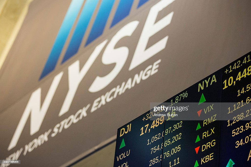 A screen displays stock prices on the floor of the New York Stock Exchange during the afternoon of October 22 2015 in New York City The Dow Jones...