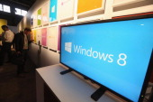 A screen displays the logo of the Microsoft Windows 8 operating system at a press conference for the launch of the system on October 25 2012 in New...