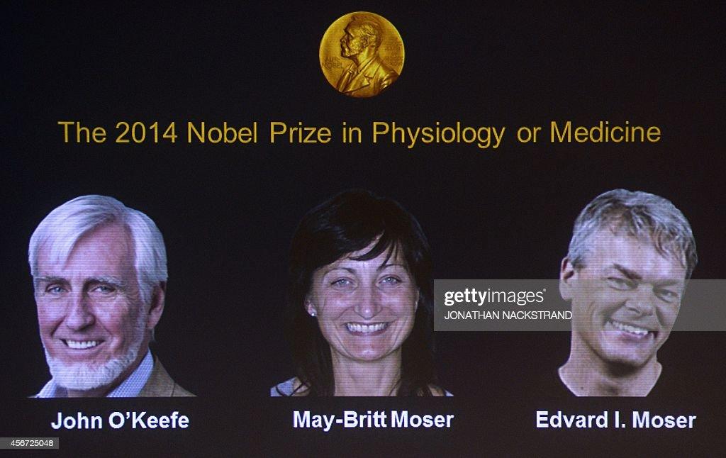 A screen displays the winners of the 2014 Nobel Medicine Prize on October 6 2014 at the Karolinska Institutet in Stockholm Sweden BritishAmerican...