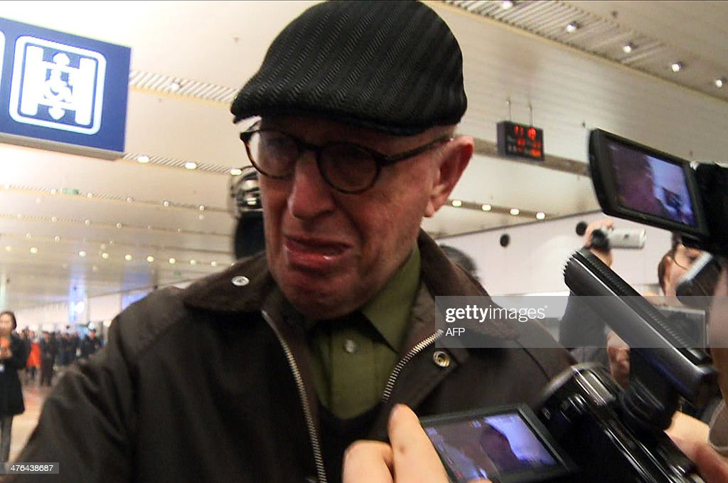 A screen grab taken from AFPTV on March 3, 2014 shows 75-year-old Australian missionary John Short arriving at Beijing international airport following his release from North Korea after being detained for distributing religious material. Hong Kong-based Short had been arrested weeks ago after leaving 'Bible tracts' in a Buddhist temple in Pyongyang during a tour.