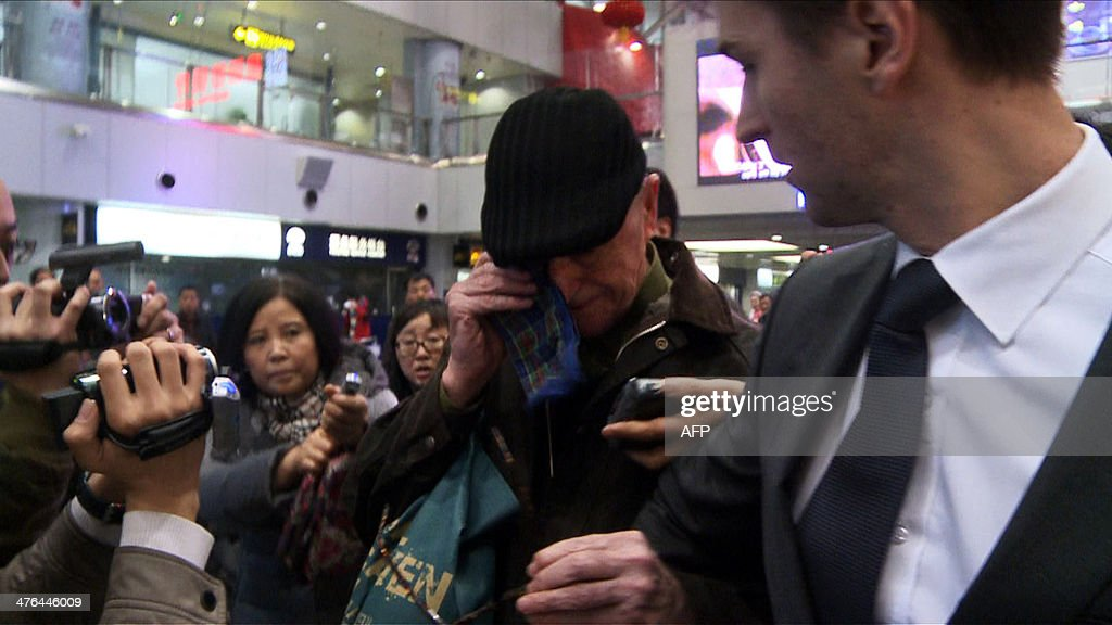A screen grab taken from AFPTV on March 3, 2014 shows 75-year-old Australian missionary John Short being emotional upon arriving at Beijing international airport following his release from North Korea after being detained for distributing religious material. Hong Kong-based Short had been arrested weeks ago after leaving 'Bible tracts' in a Buddhist temple in Pyongyang during a tour.