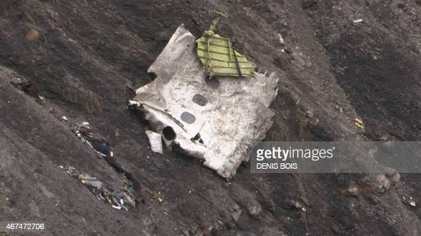 A screen grab taken from an AFP TV video on March 24 2015 shows debris of the Germanwings Airbus A320 at the crash site in the French Alps above the...