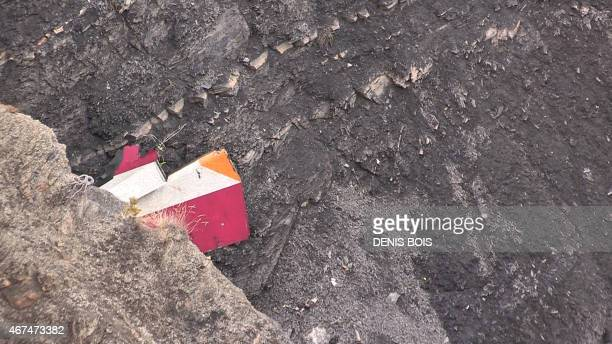 A screen grab taken from an AFP TV video on March 24 2015 shows part of the vertical stabilizer of the Germanwings Airbus A320 at the crash site in...