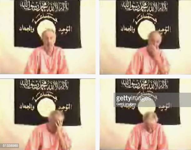 Screen grabs taken from an Islamist website on September 23 2004 allegedly shows British hostage Kenneth Bigley who was abducted at gun point by...