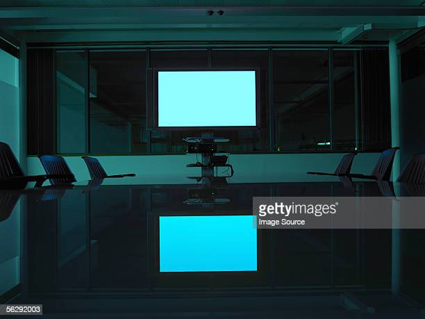 A screen in an empty board room