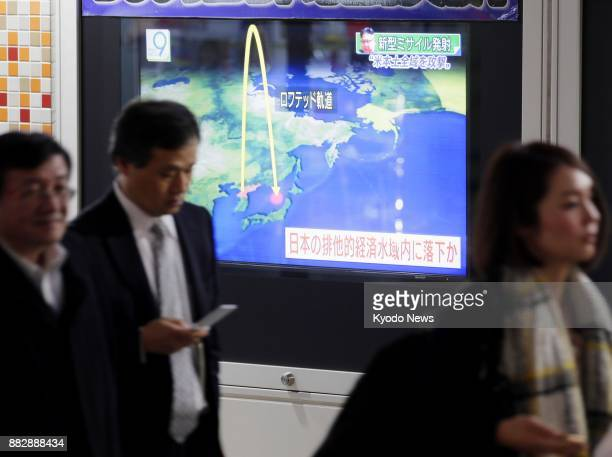 A TV screen in Tokyo on Nov 29 reports that North Korea has testlaunched an intercontinental ballistic missile the same day claiming it could hit the...