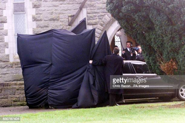 A screen is pulled around the car outside the Church of the Immaculate Conception Rathfeigh Co Meath to hide Irish boy band Westlife singer Bryan...