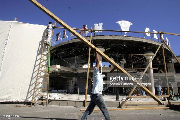 A screen is put up at the Tiran Centre in the old Town of Sharm Egypt after it was bombed One Briton is known to have died in the bombings at the...