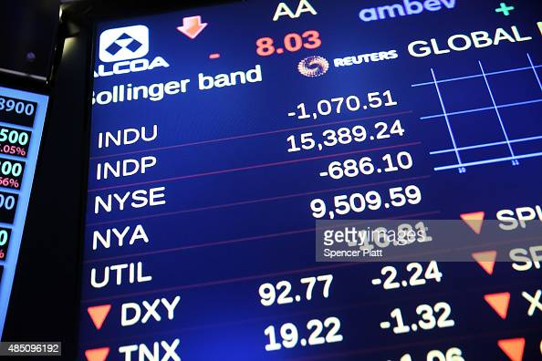 A screen on the floor of the New York Stock Exchange shows the the Dow Jones industrial average briefly dropping over 1000 points in morning trading...