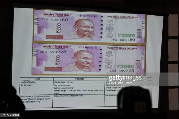 Screen printing of two kinds of 2000 rupee notes shown by Congress leader Kapil Sibal to media on August 8 2017 in New Delhi India
