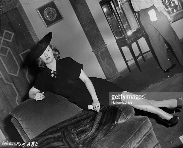 Screen queen Bette Davis sitting down for a smoke during the production of Curtis Bernhardt's 'A Stolen Life' a Warner Brothers remake of the 1939...