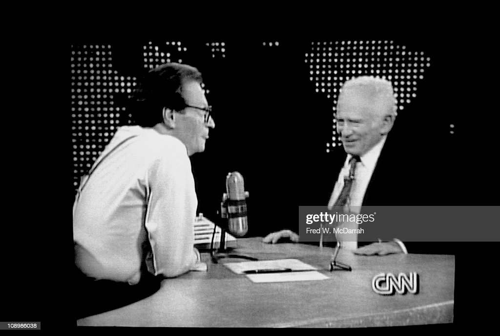 Screen shot shows American author Norman Mailer (1923 - 2007) (right) as he smiles during an with television host Larry King on the latter's CNN show, New York, New York, early 1990s.