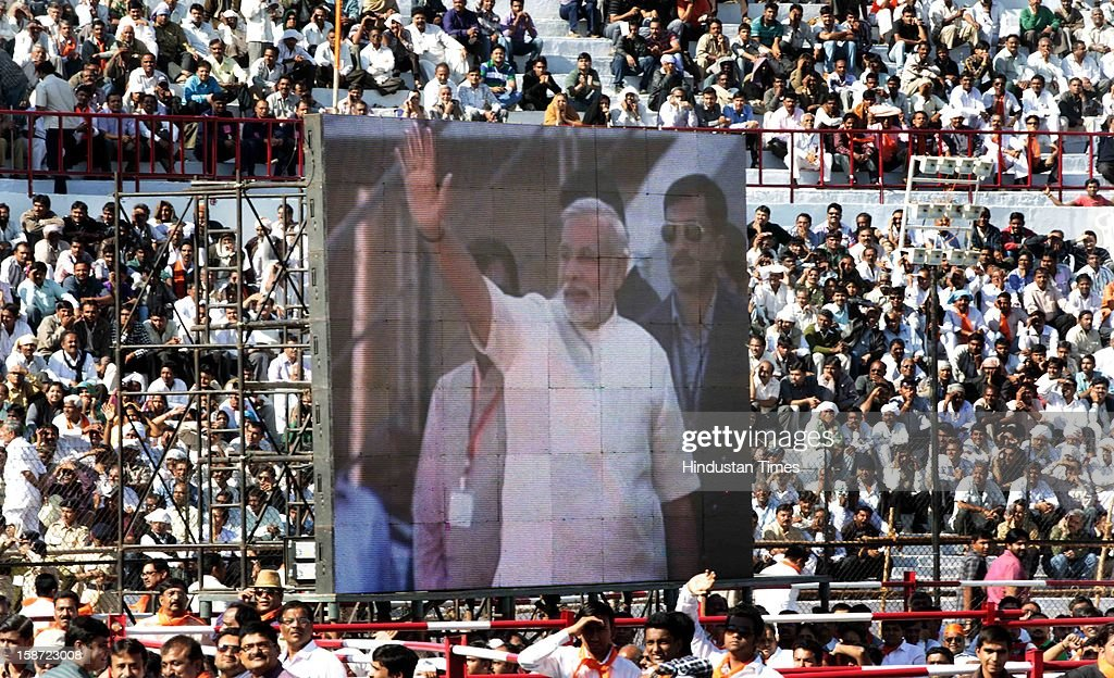 Screen showig Gujarat Chief Minister Narandra Modi Narendra Modi during his swearing in ceremony at a grand function at Sardar Patel Stadium on December 26, 2012 in Ahmedabad, India. Narendra Modi sworn as Chief Minister of Gujarat for fourth successive term.