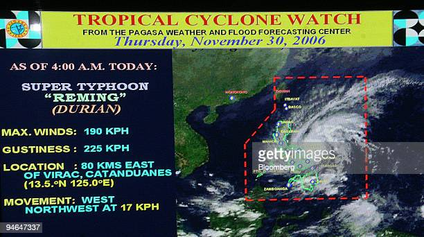 TV screen showing Supertyphoon Durian seen in the satellite image passing over the Island of Catanduanes on Thursday November 30 is pictured at the...