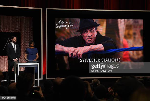 A screen showing the Oscar nominee Sylvester Stallone for the Best Actor in a Supporting Role is announced by actor John Krasinski and Academy...
