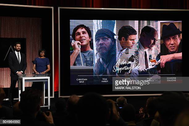 A screen showing the Oscar nominees for the Best Actor in a Supporting Role is announced by actor John Krasinski and Academy President Cheryl Boone...