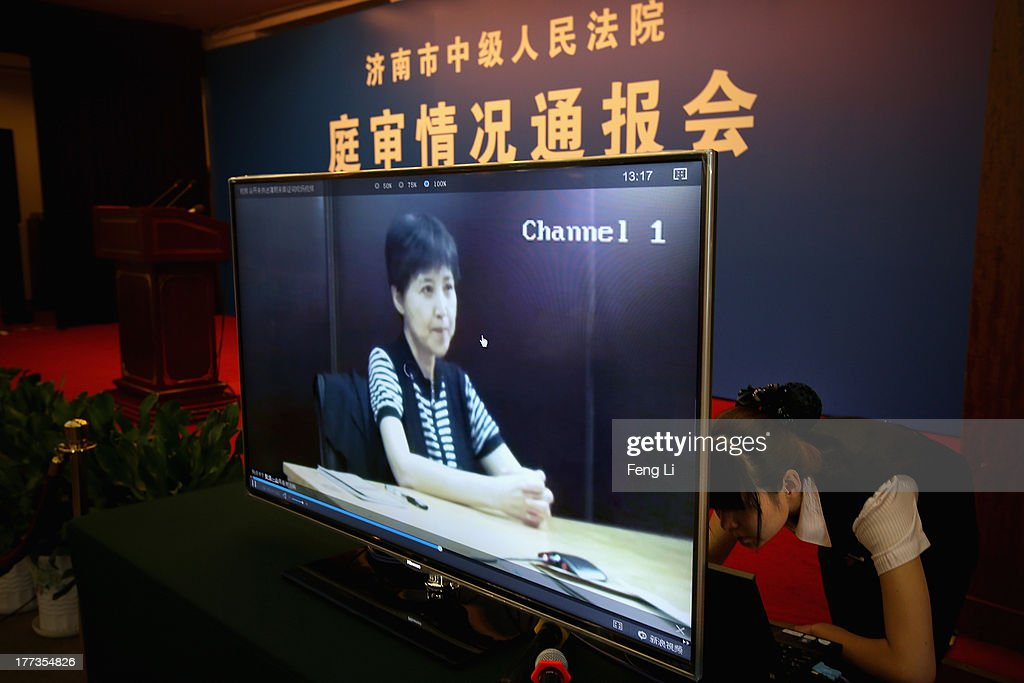 A screen shows a video of Gu Kailai, wife of ousted Chinese Communist Party Politburo member Bo Xilai at the media room for Bo Xilai's trial on August 23, 2013 in Jinan, China. Ousted Chinese politician Bo Xilai is standing trial on charges of bribery, corruption and abuse of power for a second straight day. Bo Xilai made global headlines last year when his wife Gu Kailai was charged and convicted of murdering British businessman Neil Heywood.
