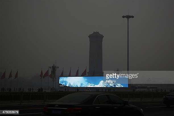 LED screen shows the blue sky in Tiananmen Square during dangerous levels of air pollution on February 26 2014 in Beijing China The air pollution has...