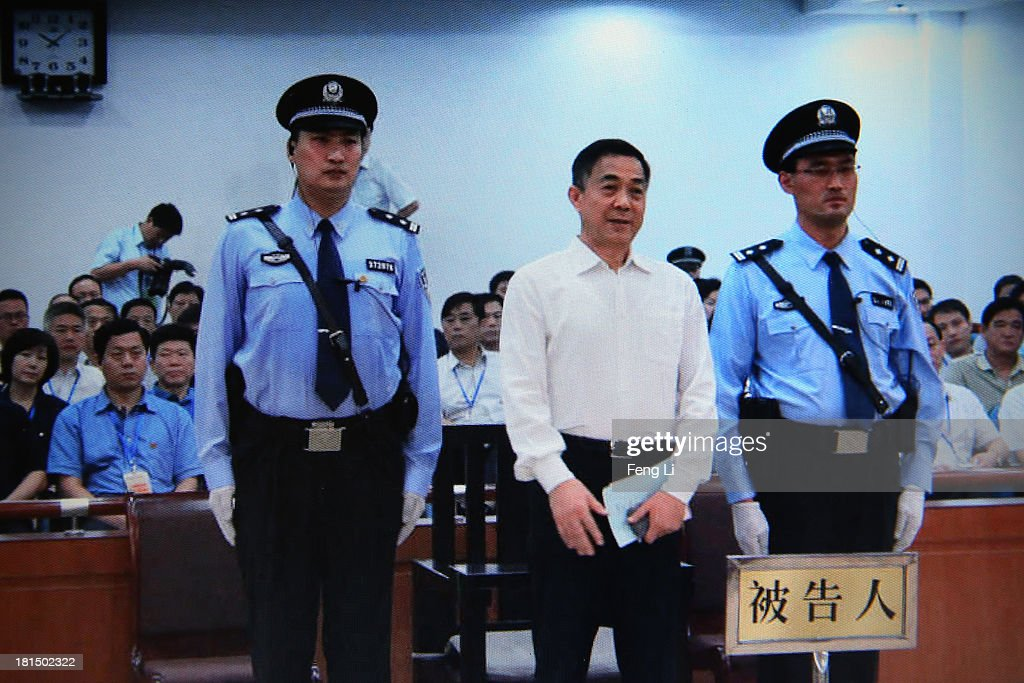 A screen shows the picture of the sentence of Chinese politician <a gi-track='captionPersonalityLinkClicked' href=/galleries/search?phrase=Bo+Xilai&family=editorial&specificpeople=225006 ng-click='$event.stopPropagation()'>Bo Xilai</a> (Center) on September 22, 2013 in Beijing, China. The Jinan Intermediate People's Court started Sunday to announce <a gi-track='captionPersonalityLinkClicked' href=/galleries/search?phrase=Bo+Xilai&family=editorial&specificpeople=225006 ng-click='$event.stopPropagation()'>Bo Xilai</a> sentenced life imprisonment for bribery, embezzlement, power abuse.