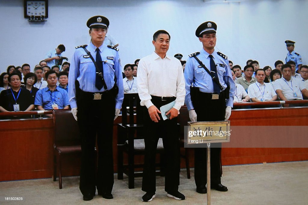 A screen shows the picture of the sentence of Chinese politician Bo Xilai (Center) on September 22, 2013 in Beijing, China. The Jinan Intermediate People's Court announced Bo Xilai, former member of the CPC Central Committee Political Bureau, was sentenced to life imprisonment on Sunday for bribery, embezzlement and abuse of power.